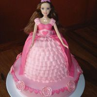 Pink Barbie Princess Cake Doll cake is strawberry cream with buttercream filling and base cake is vanilla with buttercream filling. Both are covered in MMF with MMF...