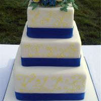 Blue And Yellow Wedding Fondant covered. First time doing gumpaste carnations.