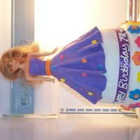 Barbie Doll On 2-Tiered Cake  I made a barbie doll cake and placed her on top of a 2-tiered cake. The fondant was homemade...I used a marshmallow fondant recipe. I used...