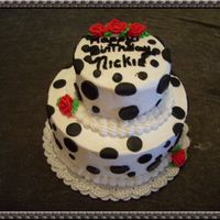 Polka Dot Fun White two tier buttercream with fondant black dots.