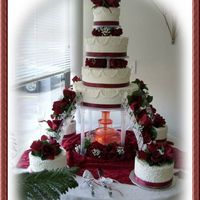 "Lace And Roses 4 tier buttercream with 4 8"" round satellite cakes done in cornelli lace."