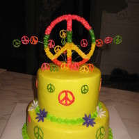 Peace 8 inch and 6 inch all buttercream with white chocolate peace signs and fondant flowers. tfl