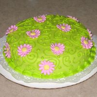 Pink Daisies Just a cake I did for fun. Green swirls and dots with pink royal daisies.