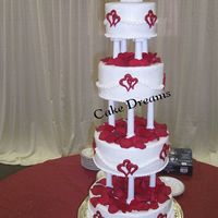 Kristi's Cake 12x10x8x6. Butter cream with red colorflow hearts.