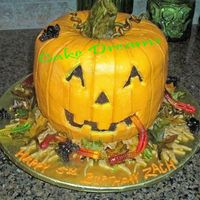Halloween Birthday Jack-O-Lantern Chocolate cake with BC icing and fondant stem and leaves.Gummy worms and spiders.