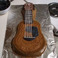 Guitar First cake with character pan. French vanilla cake with crusting cream cheese frosting (thanks CCBB).