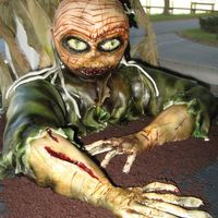 Half Body Zombie My 3rd zombie cake! For a customer's Halloween party on Halloween night. The body is cake and head is rice krispies.