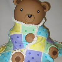 Teddy Bear Cake I made this to match the baby shower invitations. Teddy is stacked up round cakes with a ball pan head.