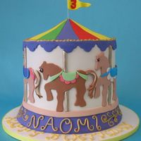 Carousel Cake a little girl's 3rd birthday cake for a party held at a carousel.