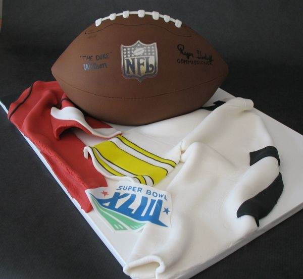 Super Bowl Xliii Cake Football cake for a super bowl party. Football is hand carved, with fondant jerseys.