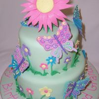 Butterfly Cake The butterflies are made from fondant, with royal icing piping. The topper I made out of gumpaste.