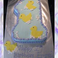 First Birthday Ducks Number one cake with bc icing and fondant ducks.