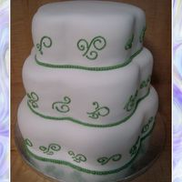 Petal Wedding Cake With Green Detail Customer wanted a petal cake and shipped her pans. Nice and simple, topper added at the restaraunt that cake was dropped off at.