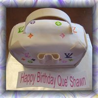 Lv Purse This is my first attempt at a purse cake. I think it came out ok!