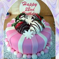 Strawberry Birthday Cake Fondant covered cake with dipped strawberries on top (per customer) and gumpaste topper.