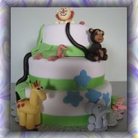 Jungle Safari Cake This was done for a first birthday. Fondant covered with fondant/gumpaste animals.