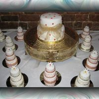 Mini Wedding Cakes Done for a wedding. Each tier covered in rolled fondant. Alot of work!
