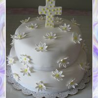 Baptisim Cake With Daisies Fondant covered with gumpaste flowers and cross. Made this one for my third daughters baptisim.