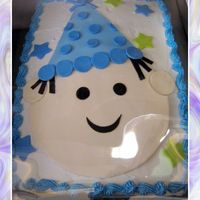 Little Boy With Birthday Hat 1/2 sheet iced with bc and done with fondant accents. Made to match plates and napkins for party.