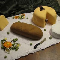 Mouse And Cheese Cake Mouse and Cheese Cake - bread is made from Rice Crispies. Brie is royal icing with mixed corn starch and icing sugar. Lots of fun making...
