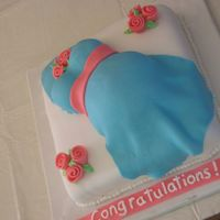 Belly Cake   Fondant covered and decorated cake.