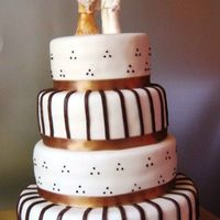 Brown Gold the cake colors was matching the wedding dress, it was a chocolate cake with chocolate-orange filling. TFL