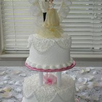 "Small Wedding Cake This cake is a two tier buttercream frosted little lovely creation. Buttercream is allowed to ""crust"" then papertoweled gently to..."