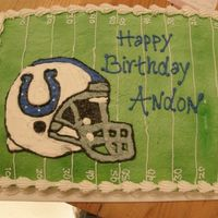 Go Colts Sheet cake with colts helmet.