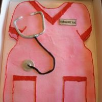 Nurse Cake Sheet cake carved to look like a shirt with fondant accesories.