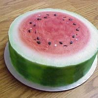 Watermelon Slice This is a simple two-layer cake that has been airbrushed, with seeds piped on with black buttercream.