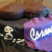 Wrestling Groom's Cake This cake was done as a surprise by one of my brides for her groom, who is a professional wrestler. We used his two wrestling uniforms and...