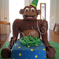 A Monkey Birthday This cake was done for my godson's 6th birthday. The monkey started with a PVC skeleton and was sculpted from a modeling chocolate/RKT...