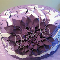 "Purple Flower  This cake was inspired by the design by TheSweetestThingCS. 8"" pink champagne cake with Bavarian Cream filling. Iced with vanilla..."