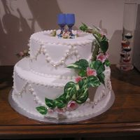 Travelling Tierd Wedding Cake  This cake was made in Newcastle and travelled by car and aeroplane to Adelaide where it was assembled. All the decorations were supplied by...
