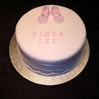 Kirra Lee  This was a chocolate mud cake, the customer want it to be 'simple and sweet' with just the booties on the top with the name. I...