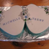 Michelle & Trent Engagement Cake  These cakes were Chocolate Mud and Caramel Mud cakes, only the top of the cake is fondant with flowerpaste decorations. The sides are...