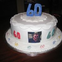 60Th Birthday Cake This is a round fruit cake, decorated with edible photos of significant moments in his life. This cake was a hit especially as it was a...