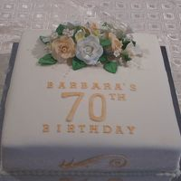 "Barbara 70Th Birthday   This was a 13"" Caramel Mud cake. This was a pretty cake despite the shear size of the cake."
