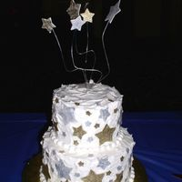 Celebration This cake was an end of the year celebration cake for my Tastefully Simple team that I am on. Iced in BC with fondant star accents painted...