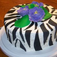 Zebra Cake With Purple Fantasy Flowers I made this for a friend's daughter. She is a very good friend and does a lot for me