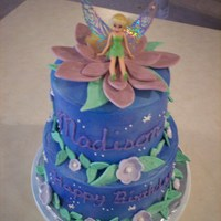 Tinkerbell This cake is covered in MMF and decorated with sugar paste flowers. The cake was for my niece, so I used a toy Tinkerbell, so she could...