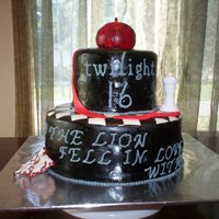 Twilight This was a Twilight cake that I made for a 16th birthday. It is covered and decorated with MMF and hand painted.