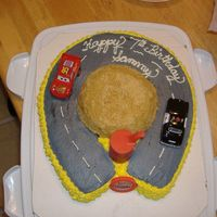 Cars Birthday Cake Cars birthday cake, all buttercream icing using horseshoe pan. I made the hill out of a bowl cake.