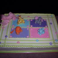 Baby Animals  Baby shower cake for a friend. The animals and all other decorations were fondant and/or gumpaste. Design came from the shower partyware,...