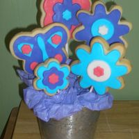 Favors_009.jpg   Cookie bouquet for a friend who just had surgery.... it really cheered her up! NFSC decorated with marhmallow fondant !