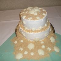 Seashell Shower! My friend and I made this for a friends bridal shower.... everyone loved it! Yellow cake, buttercream icing with nilla wafer sand and white...