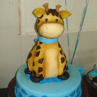 Giraffe Baby Shower Cake the giraffe is all cake, the body is vanilla cake and the head pound cake.
