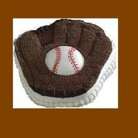 Baseball Party Mandarin Orange cake with Chocolate Icing for the Mitt and Buttercream Icing for the Ball