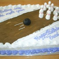 A Bowling-Themed Cake  I made this for a girls bowling party. The pins are all 3 dimensional and are made with stiff buttercream that I shaped into pins. The ball...