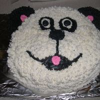 "Panda/dog Cake my 4-year old actually ""helped"" me with this cake - and he wanted LOTS of icing!....he kept insisting that it was a dog, even..."